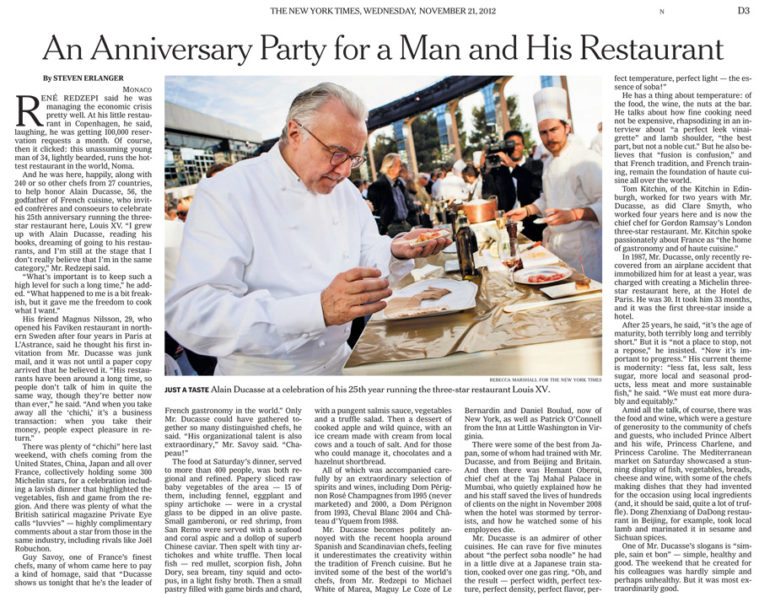Chef Alain Ducasse tastes food at a cooking demonstration stand