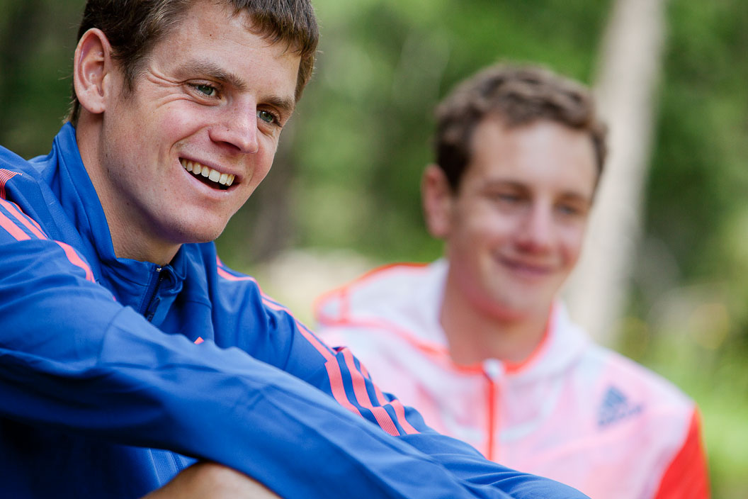 Close-up photograph of Alistair and Jonathan Brownlee in training gear outdoors