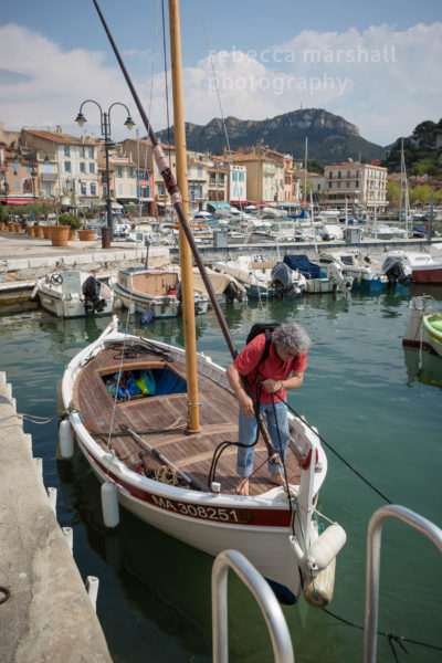 Carlo Rovelli prepares his fishing boat in the harbour of the village of Cassis