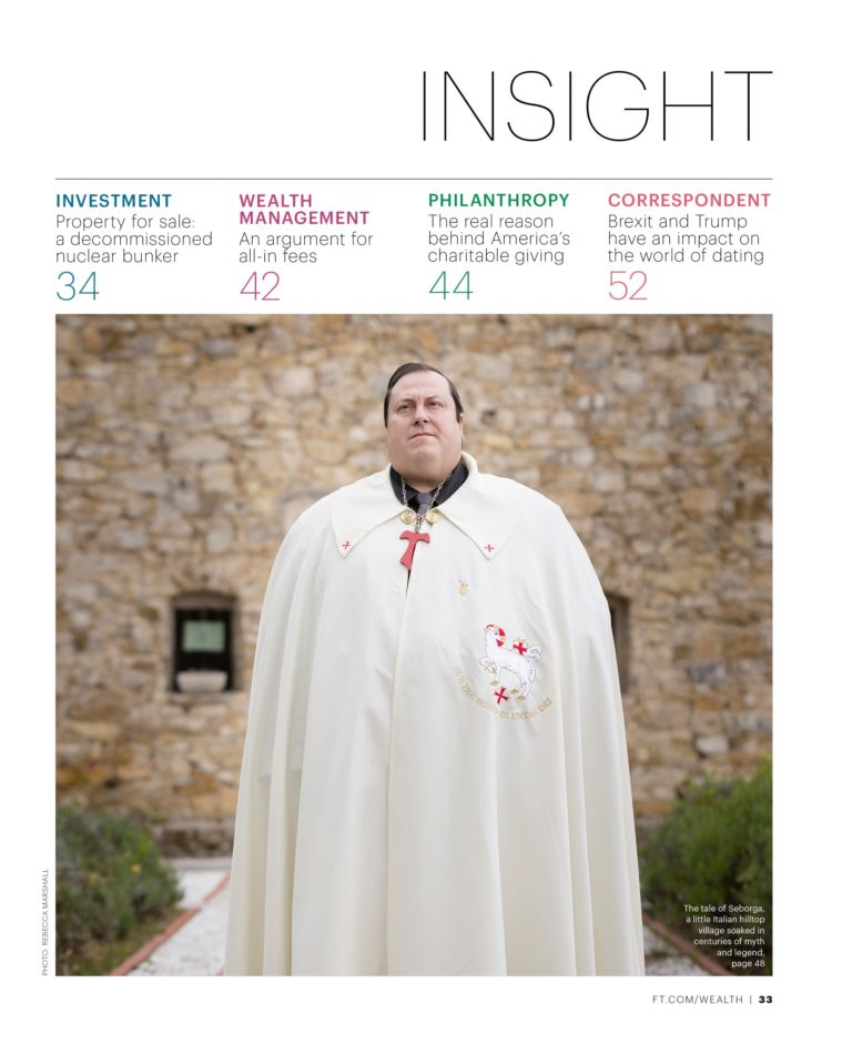 Magazine cover showing a portrait of a man standing in white robes